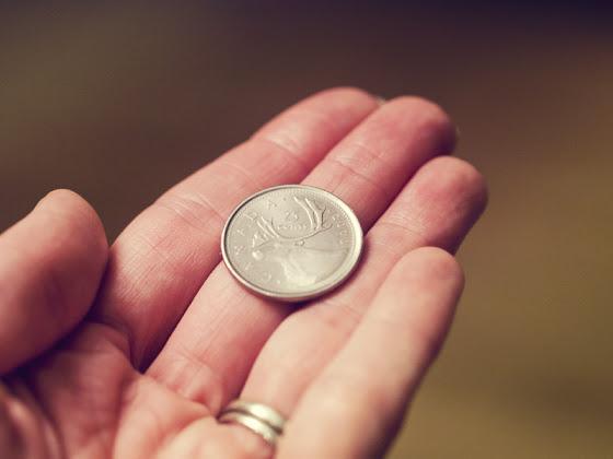 Someone Gifting a Quarter