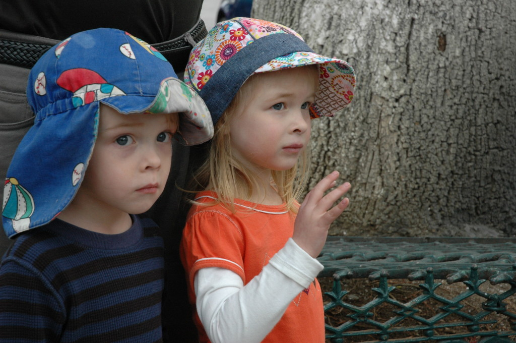 Max and Artemis watching the wise Men Parade Mexico